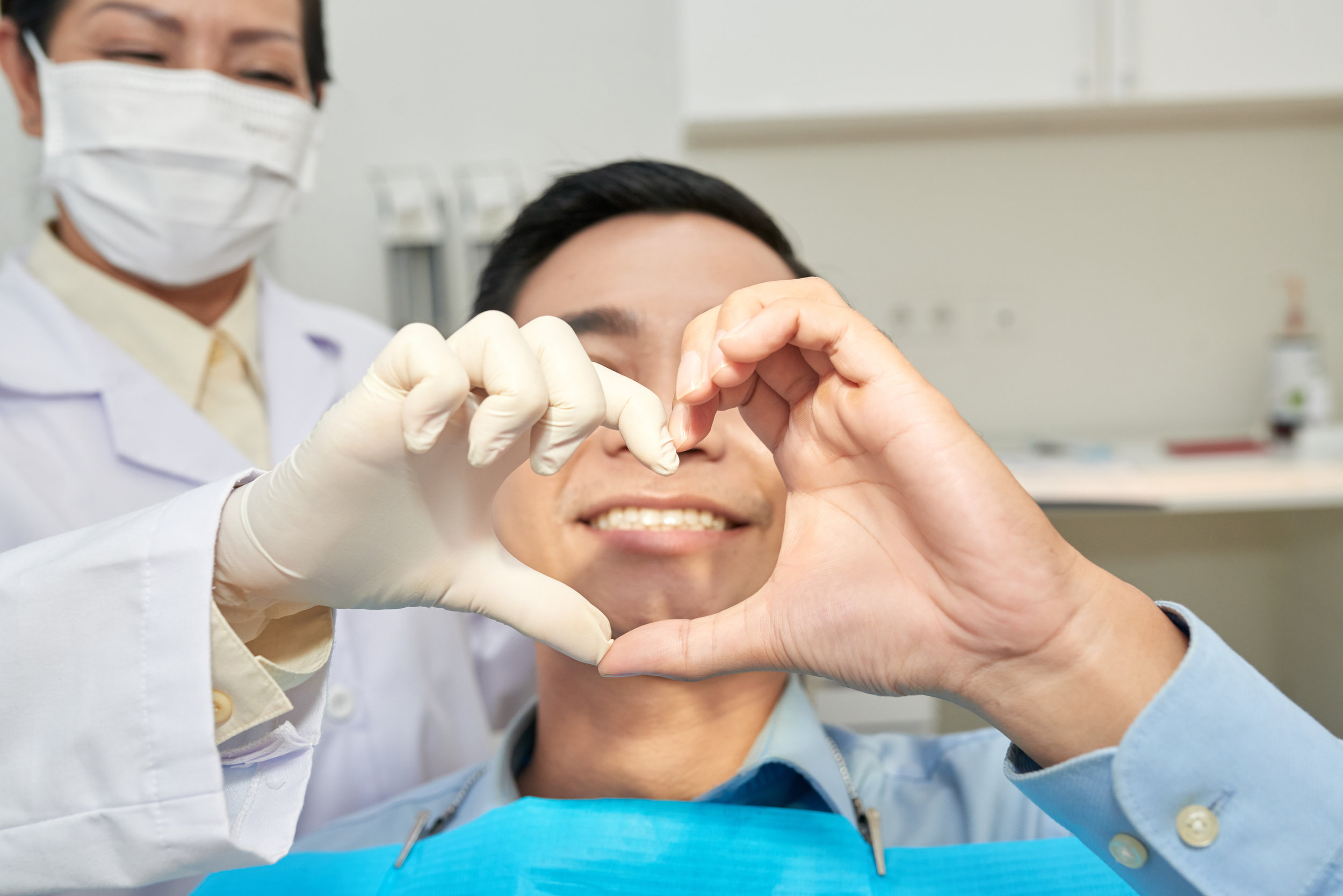 bigstock-Patient-And-Dentist-Showing-He-256418182.jpg