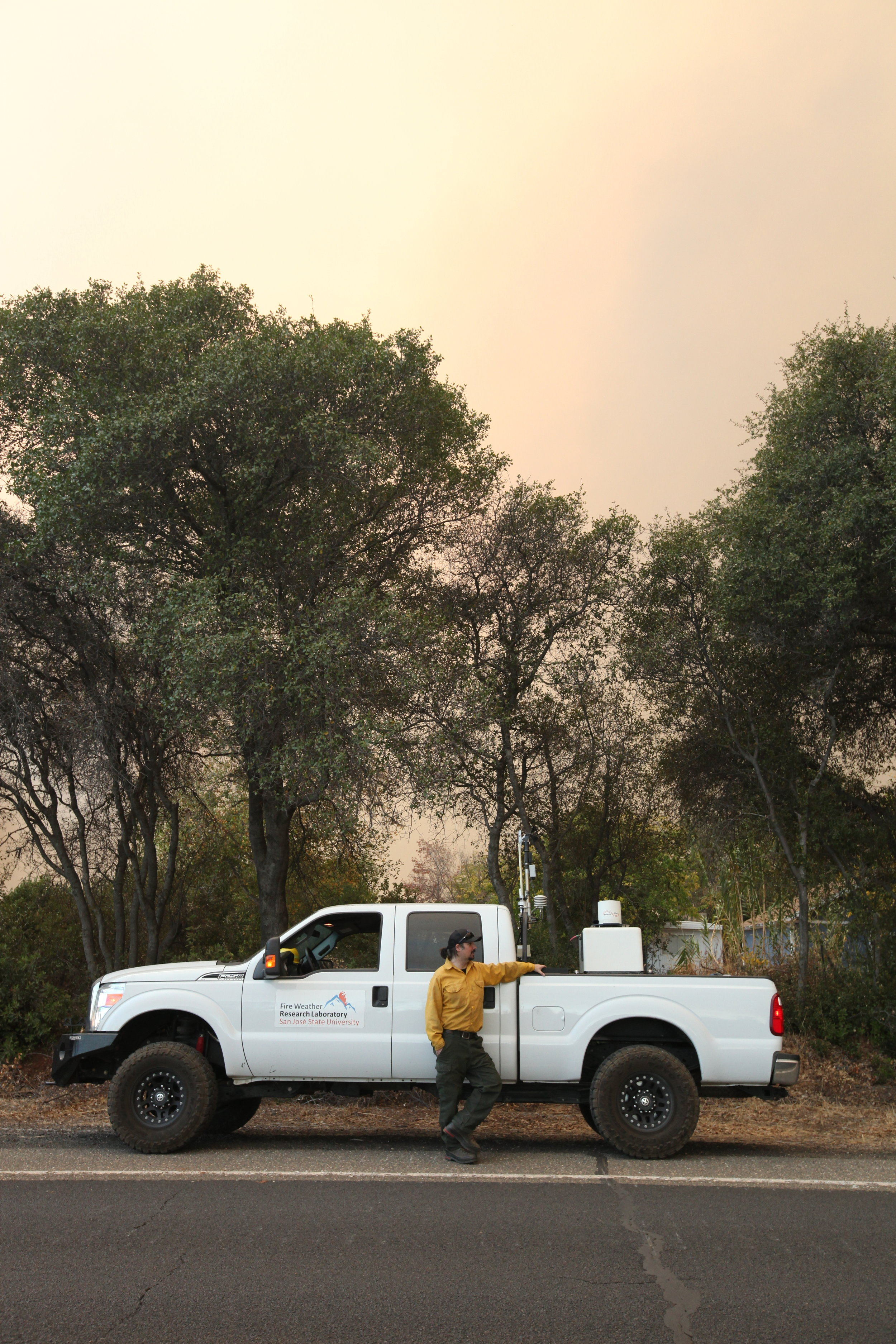 Dr. Craig Clements looks on as CalFire hand crews try to save the southern outskirts of Paradise, CA