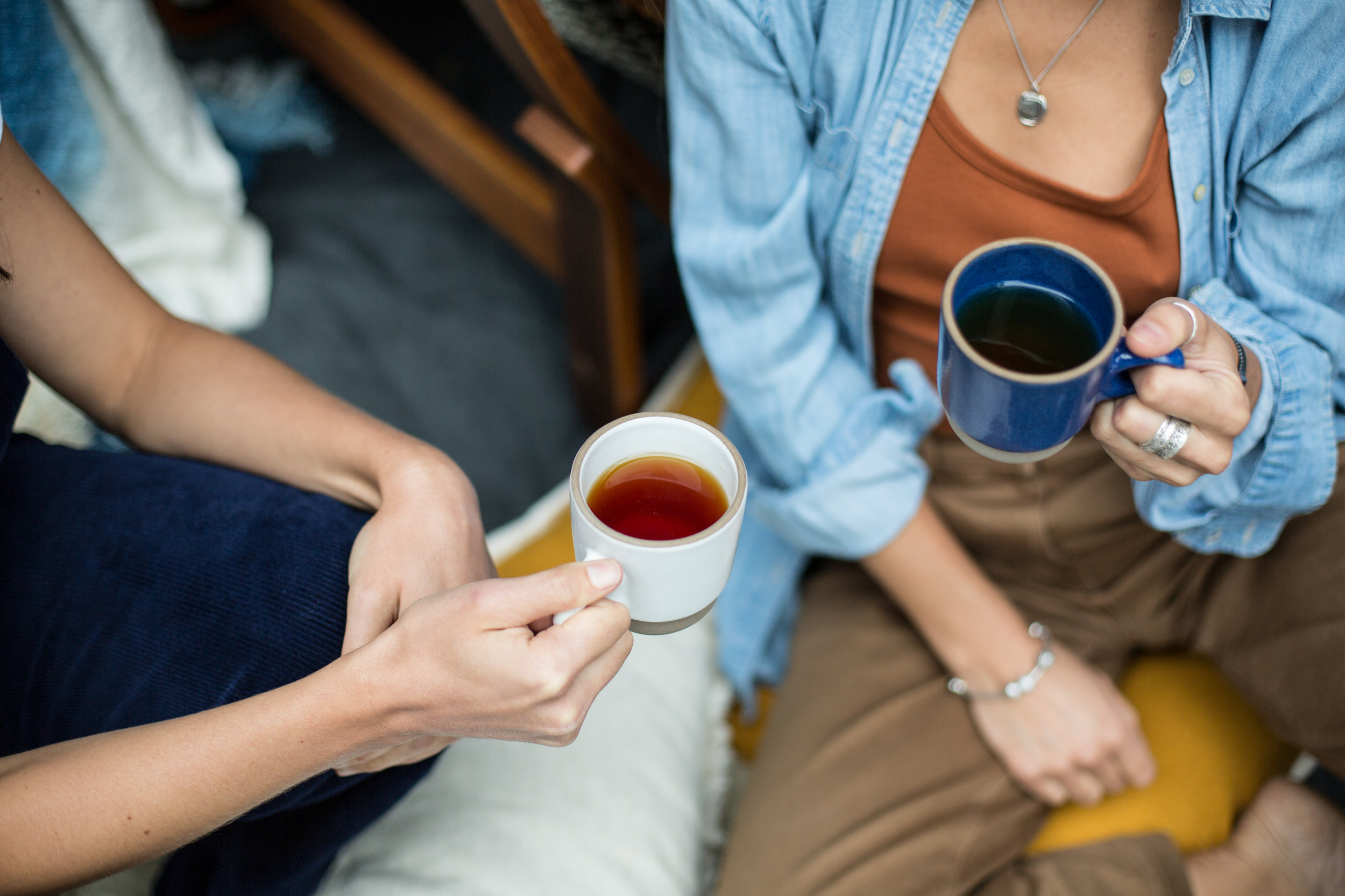 Two women drinking tea together