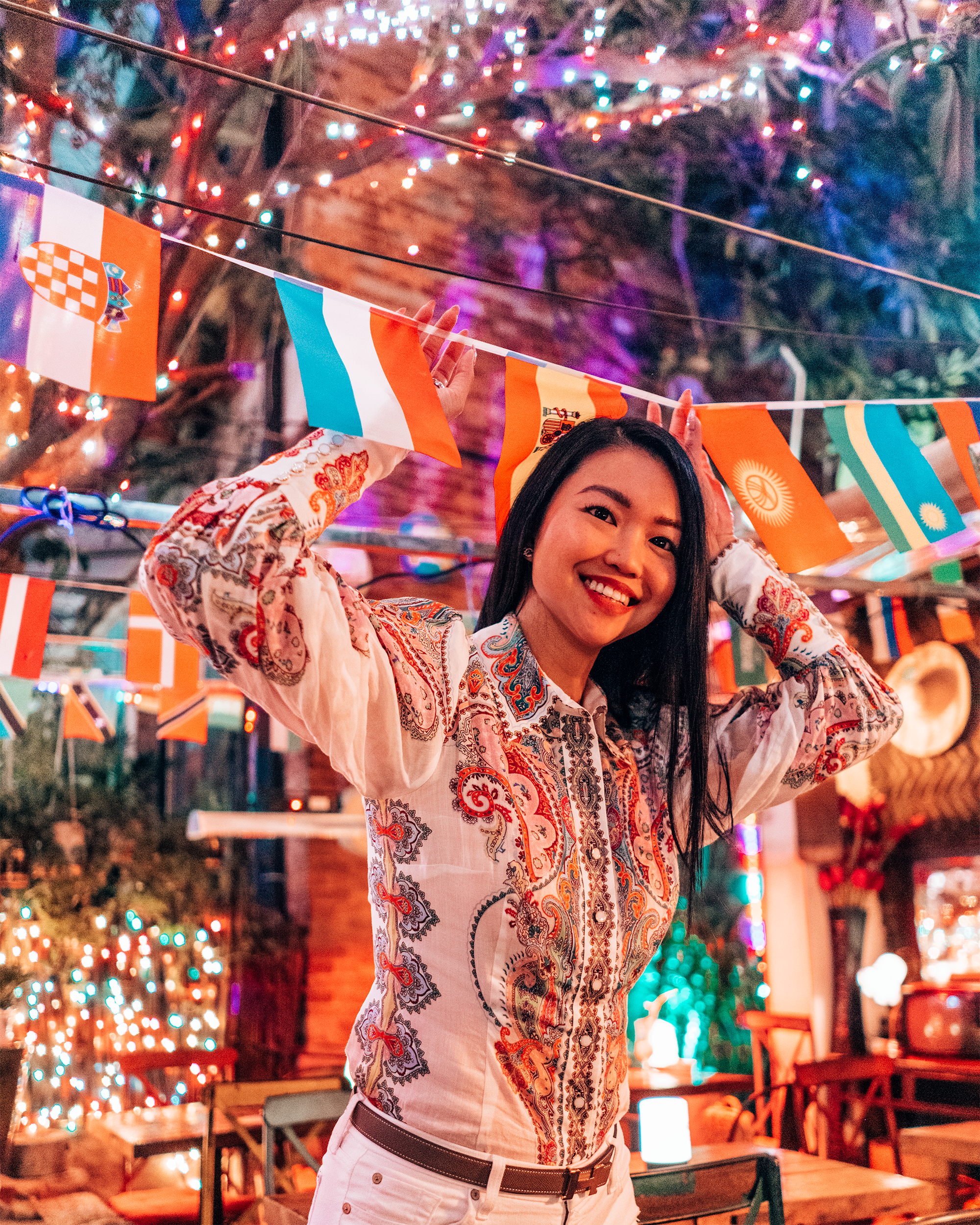 Reveling amidst neon lights in Rambler, a traveler's bar tucked away in Tianzifang.