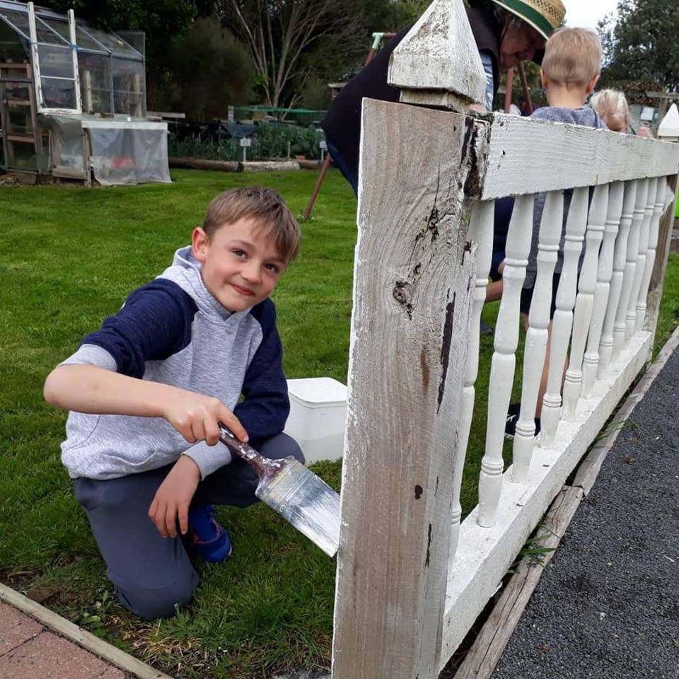 Act-of-Kindness-Volunteer-Painting-Fence.jpg