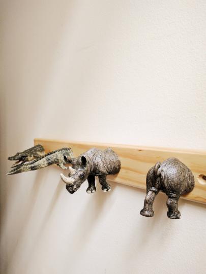 Plastic animals coatrack, detail of rhino alligator/crocodile