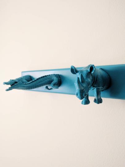 Plastic animals coatrack, detail of rhino alligator/crocodile. Painted blue