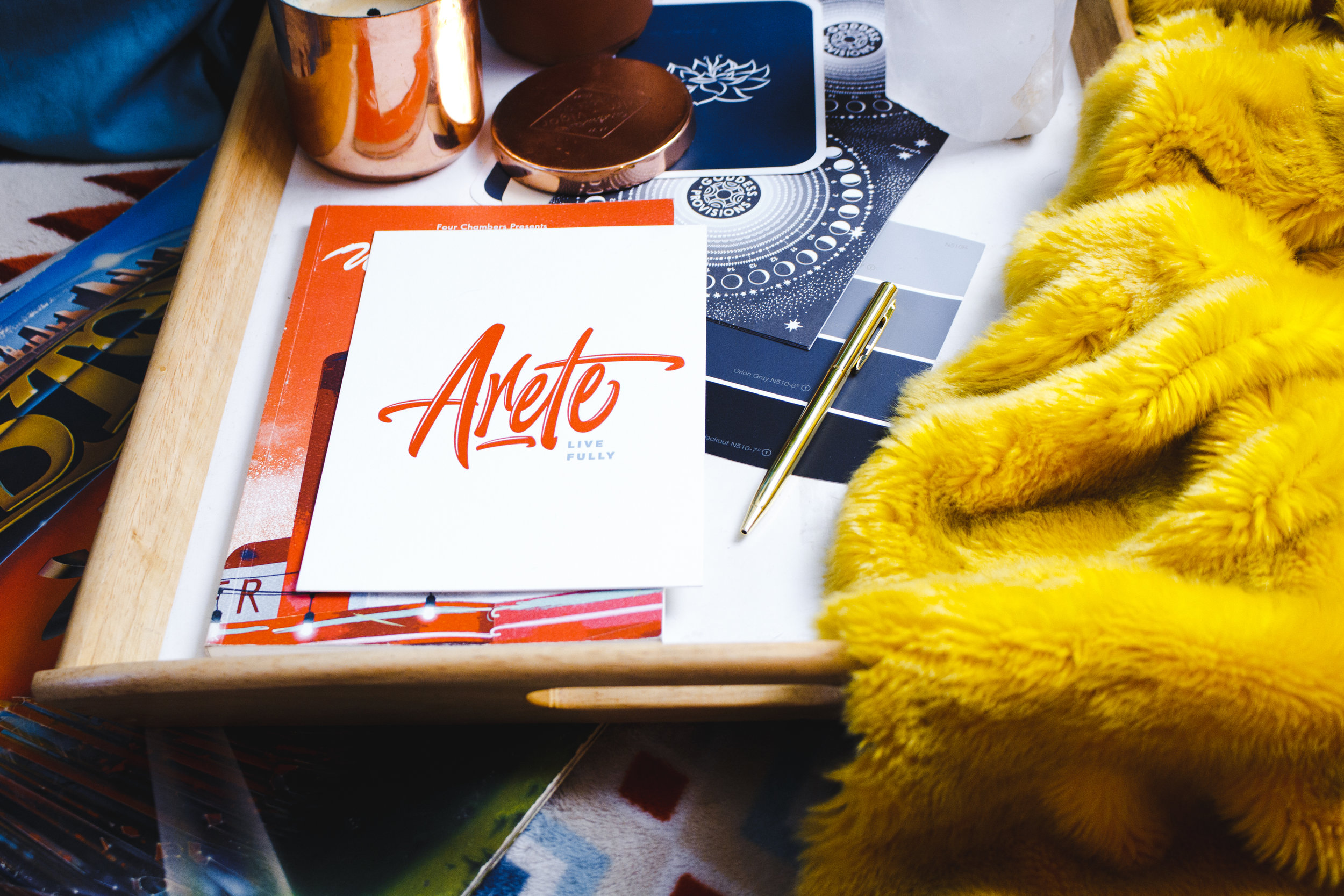Table full of art and branding materials and color palette