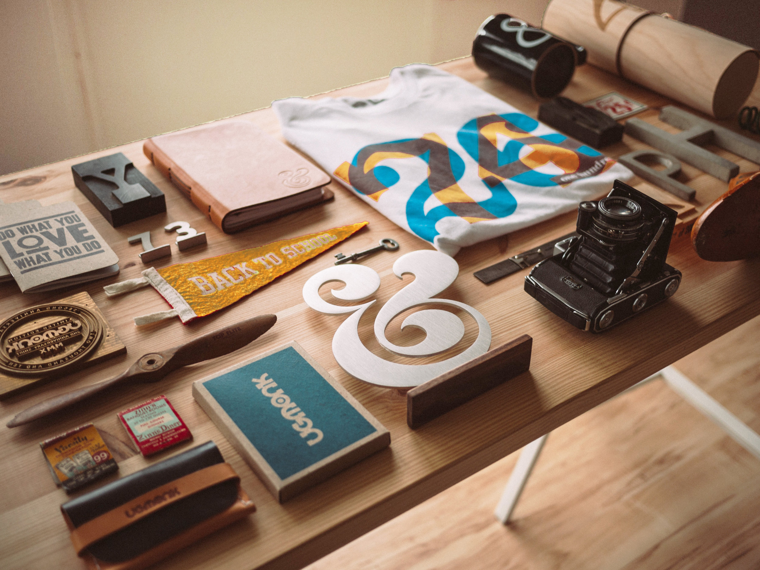 Branding materials laid out on wooden table