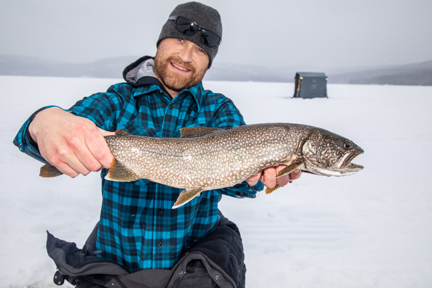 Drilling for Silver - ICE FISHING FOR LAKE TROUT AT SNOWSHOE CAMP RESORT