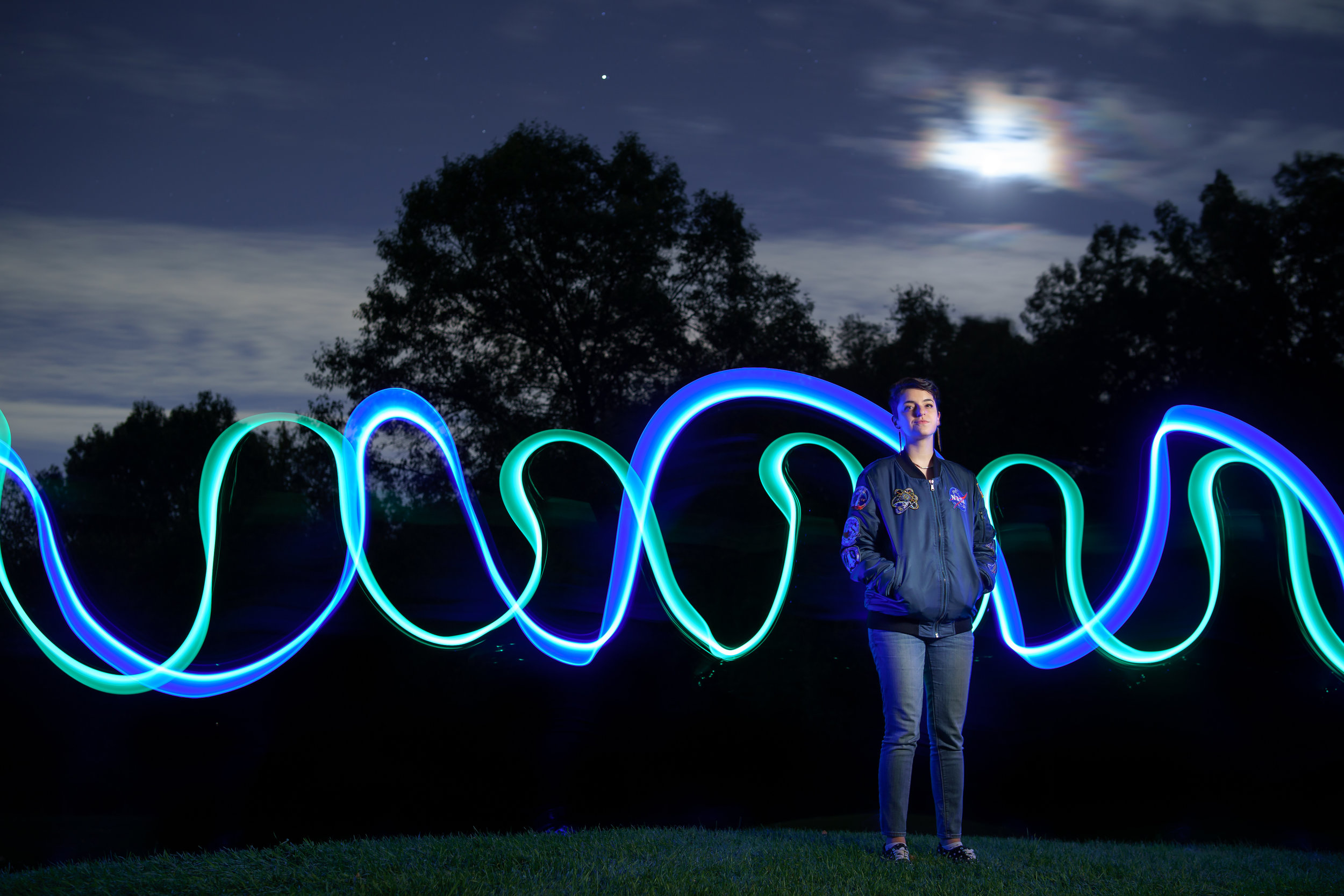Light painting behind portrait of student