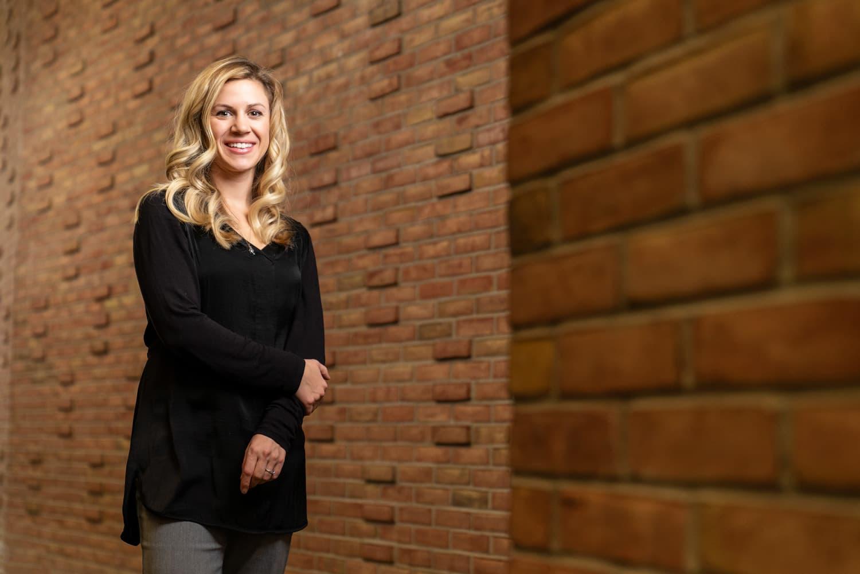 advisor standing in front of bricks