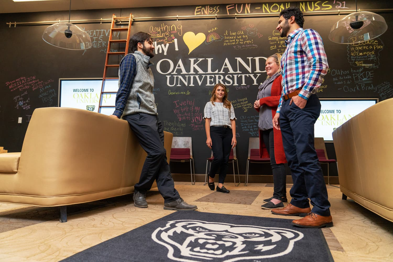Oakland university advisor Kristiana with students