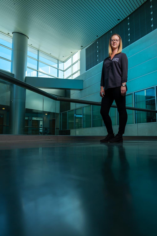 Oakland advisor standing in Pawley lobby