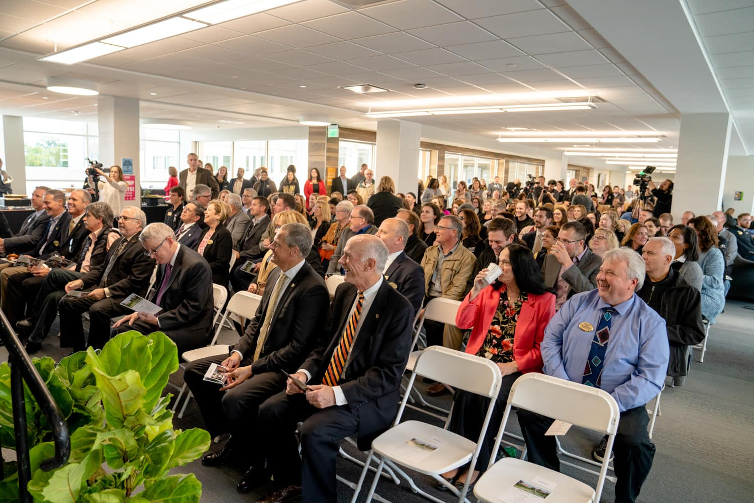 Crowd listening to speakers at grand opening of hillcrest hall at Oakland University