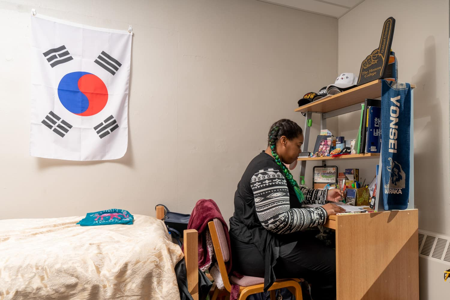 student studying at desk in dorm