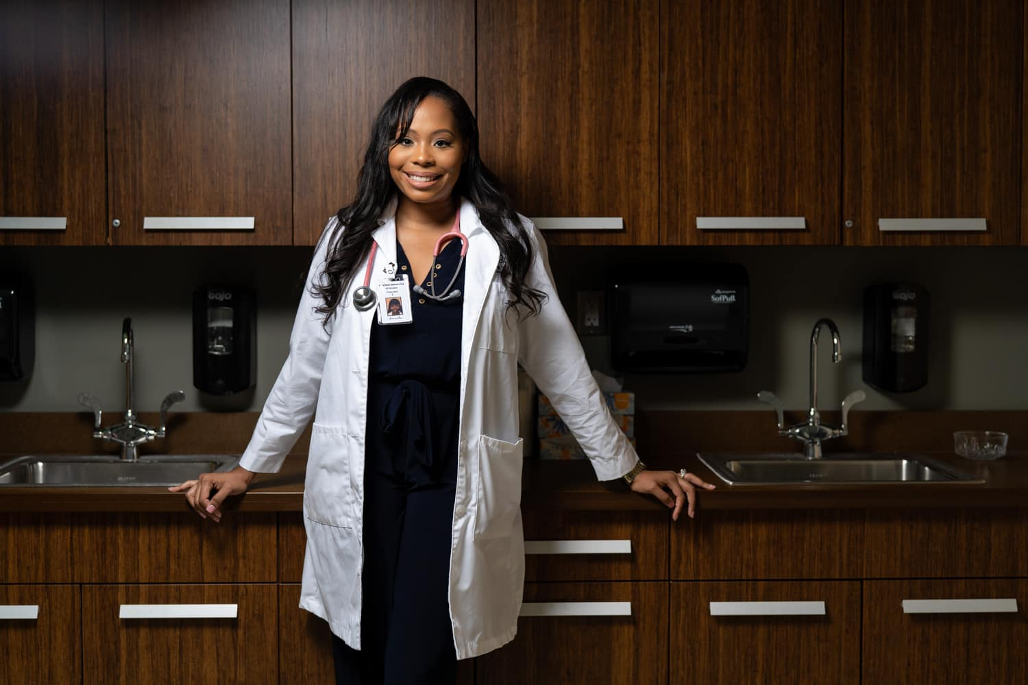 nurse practitioner in front of cabinets