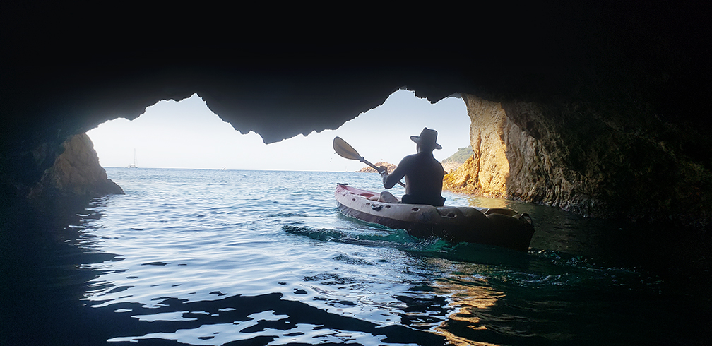 Beneath the granite cliffs a myriad of caves and inlets create spaces and sounds that change with the tide.