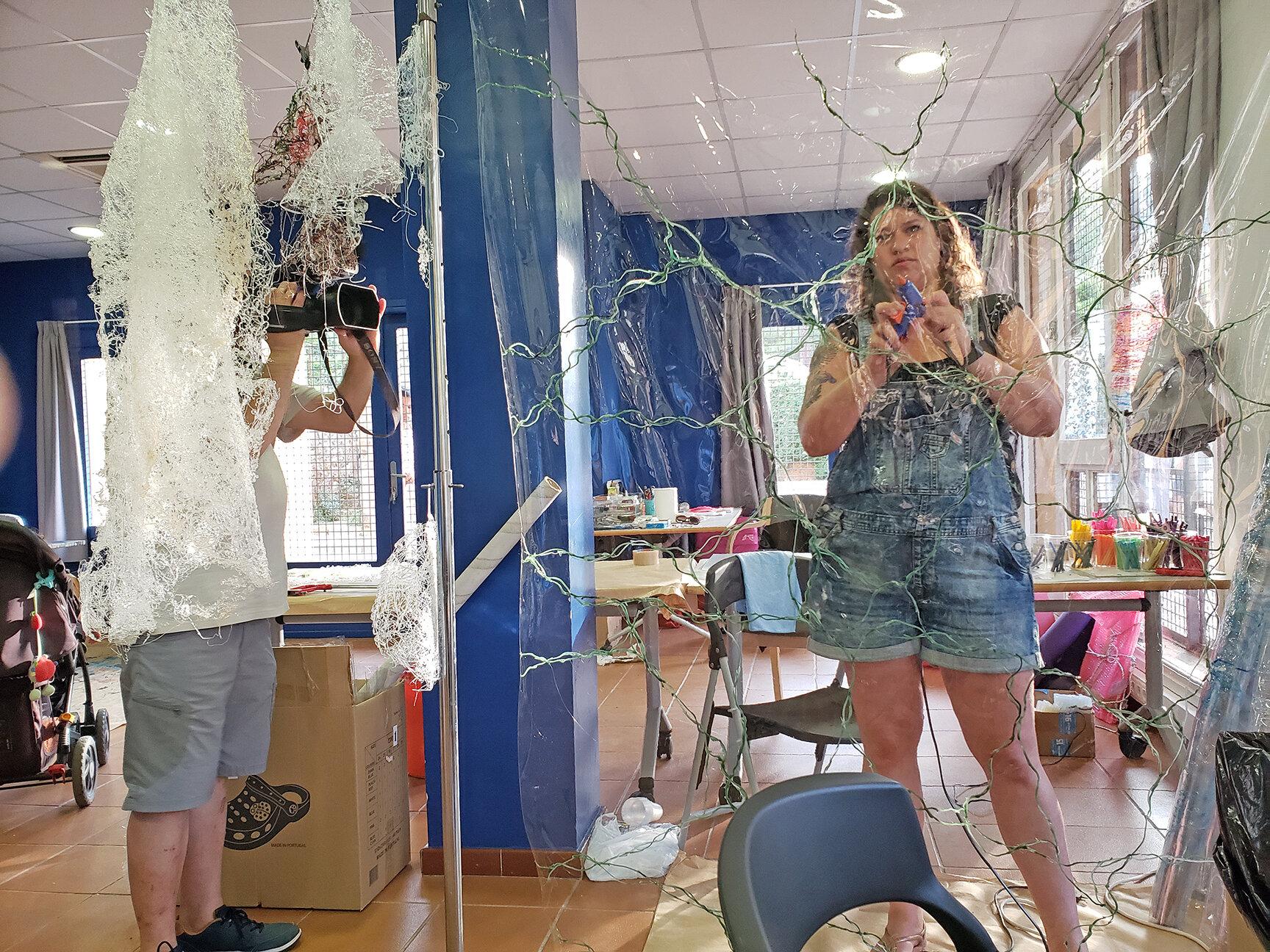 AIR.CAT 2019 resident Avital Yomdin working on her installation at the program's Espai Colomer studio.