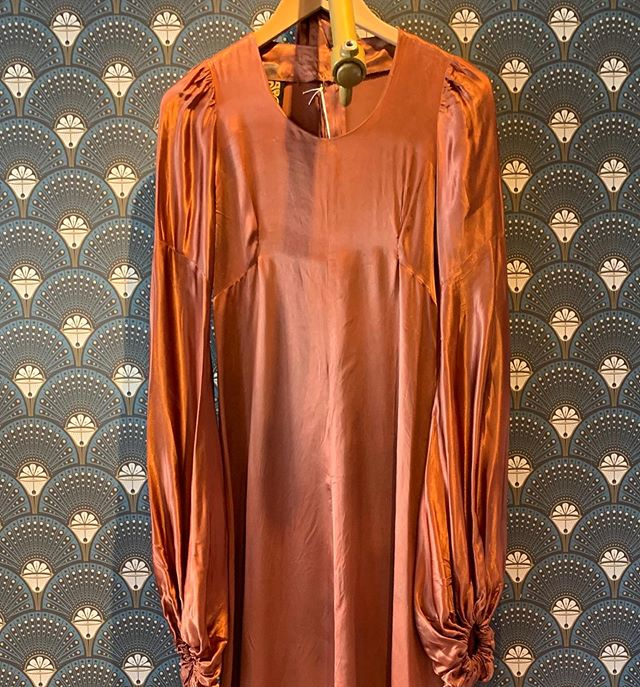 Liquid gold from out #biba collection. This 1970s dress has balloon sleeves and a long long neck tie detail. In #retrouvevintage now! @broadwaymarket