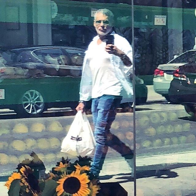 Milking the last of the strong #summer #sun while #shopping I cropped a little wider because I loved the #sunflowers in front #reflections #gaydude #gaysnap #philly #love #gratitude