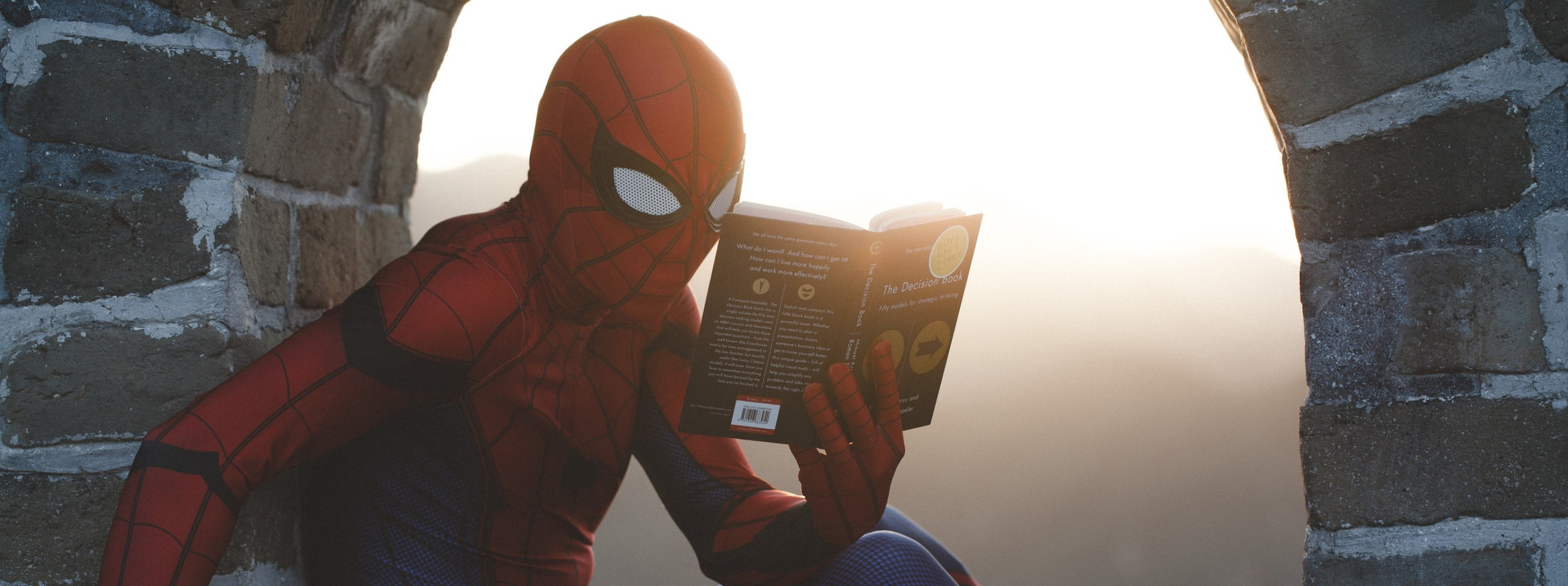 Spider Man in the wild reading up on Self Rescue Hacks!