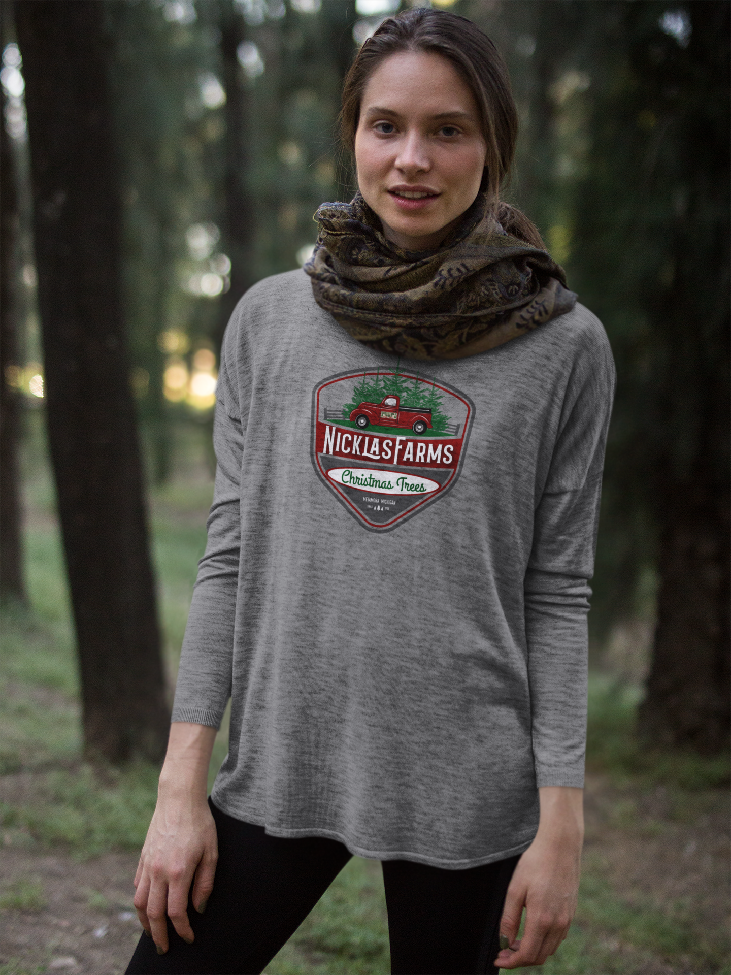 girl-wearing-a-bella-flowie-canvas-long-sleeve-tee-mockup-in-the-woods-a17921.png