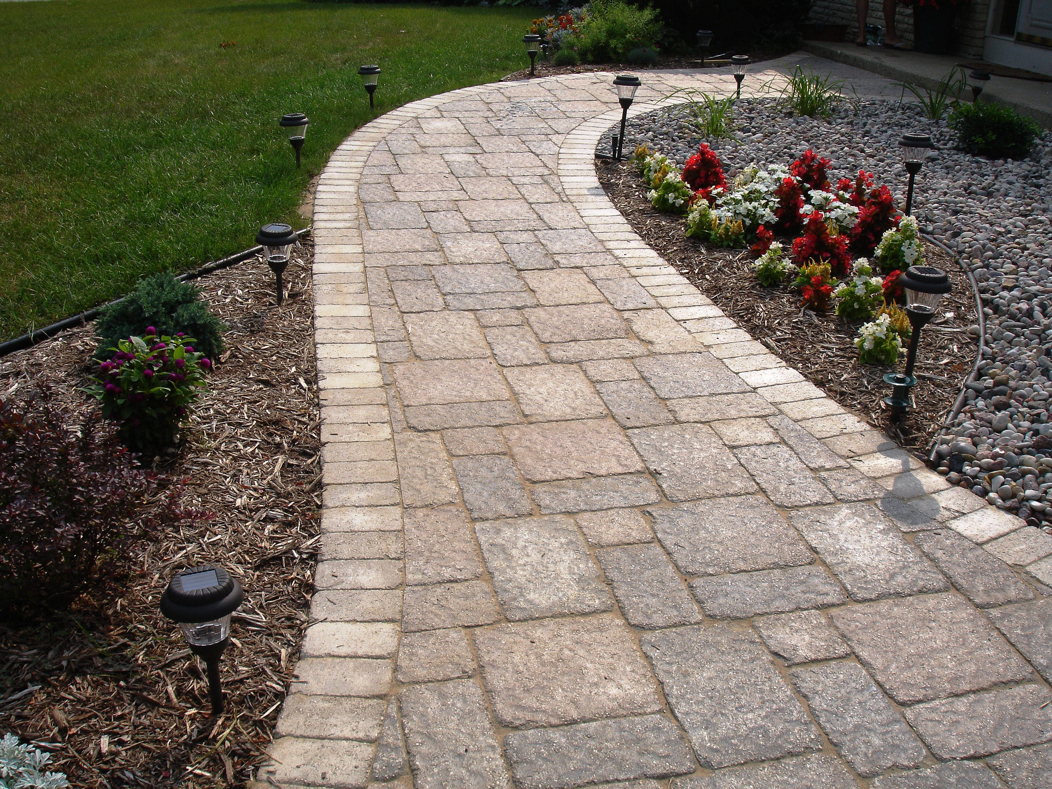 Walkway with brick pavery installed by a landscaper in Madison WI