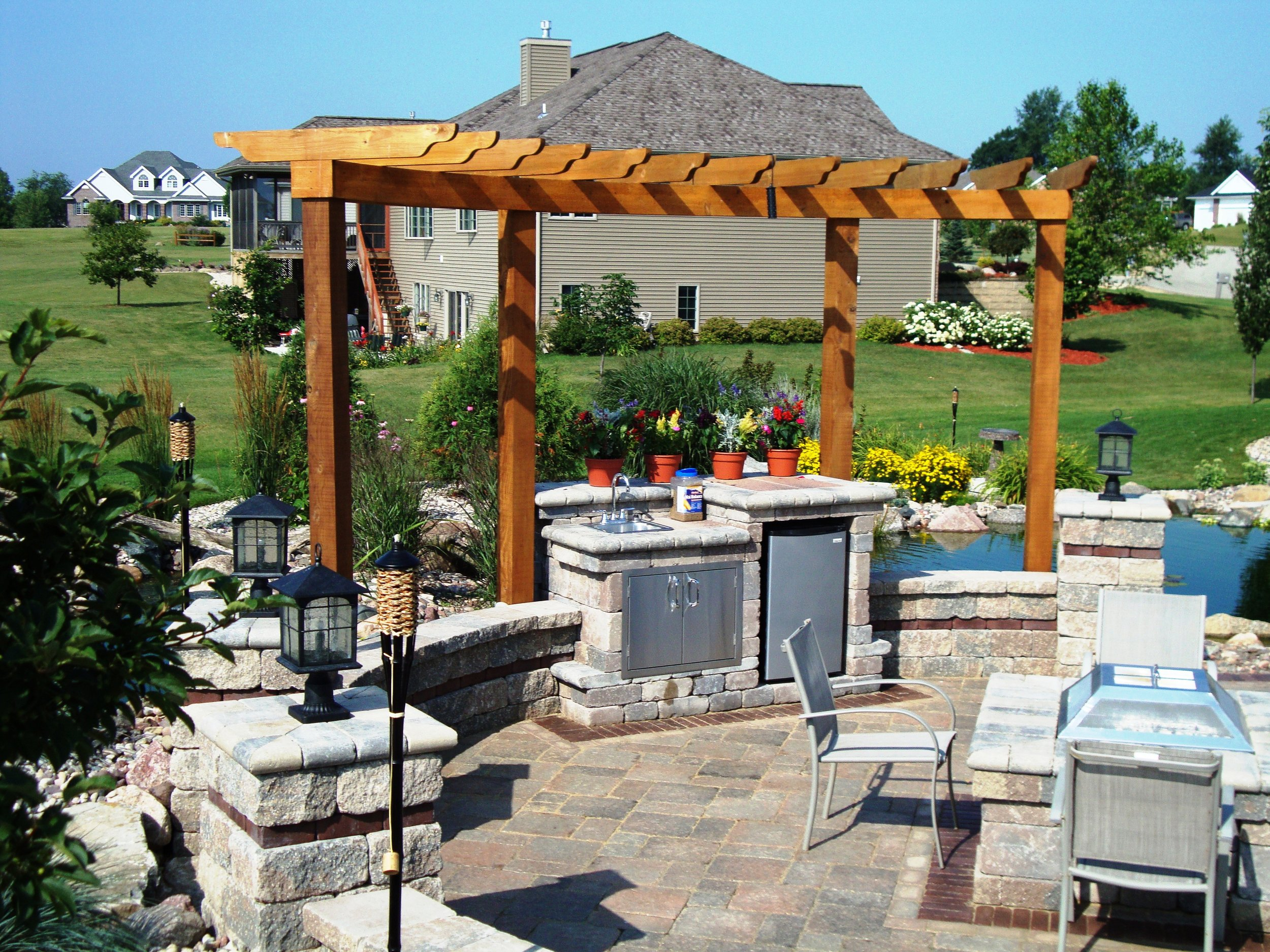 Outdoor kitchen with pergola in Madison WI