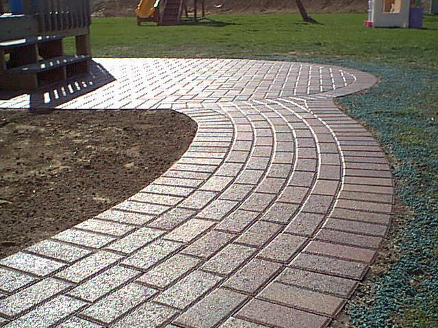 Walkways made with patio pavers are classic in utility and style in Madison WI