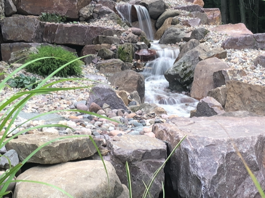 Adding Beauty and Tranquility to Your Monona, WI, Backyard with a Pondless Waterfall