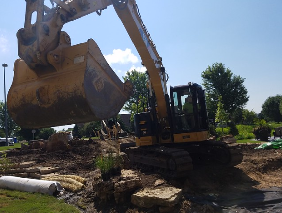 How Do Landscapers Near Me Safely Handle Large Excavation Commercial Projects in Waunakee, WI?