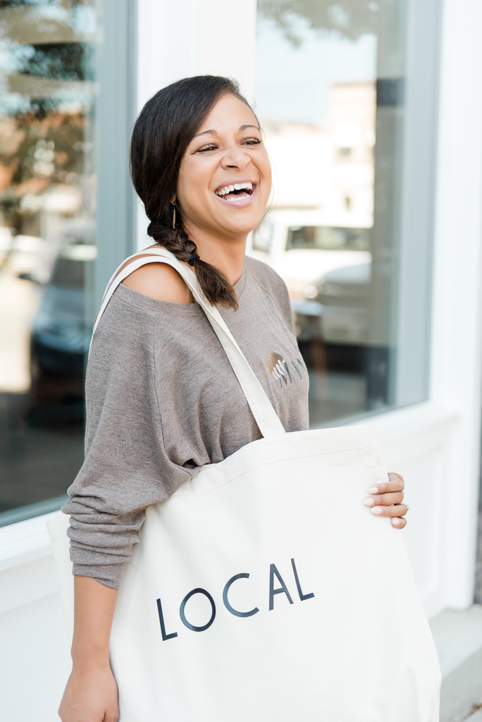 woman holding large tote bag and smiling
