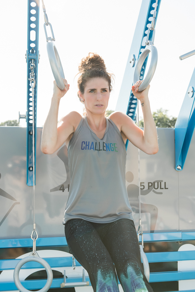 woman lifting self up in workout tank