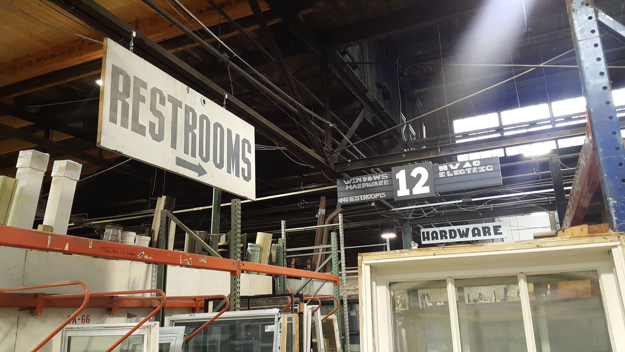 photo of intersection of aisle   The proximity of the signages may sometimes disorient users
