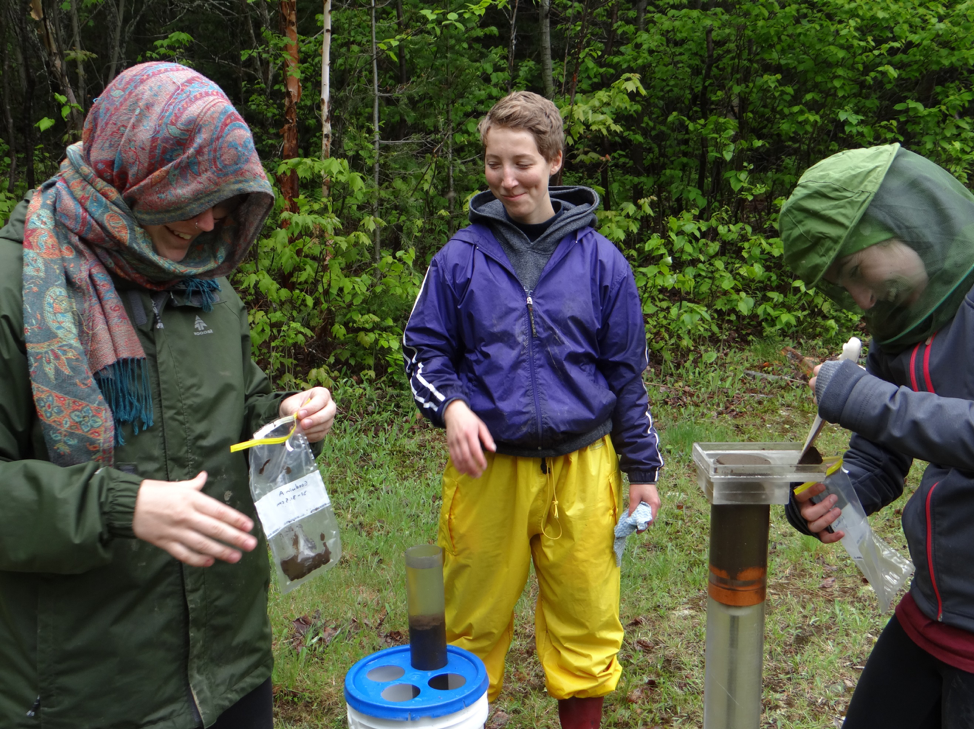Students sub-sampling a sediment core from Goodwin Lake, NB located in the headwaters of the Northwest Miramichi River. Rachel Carson highlighted this area in her seminal book Silent Spring.