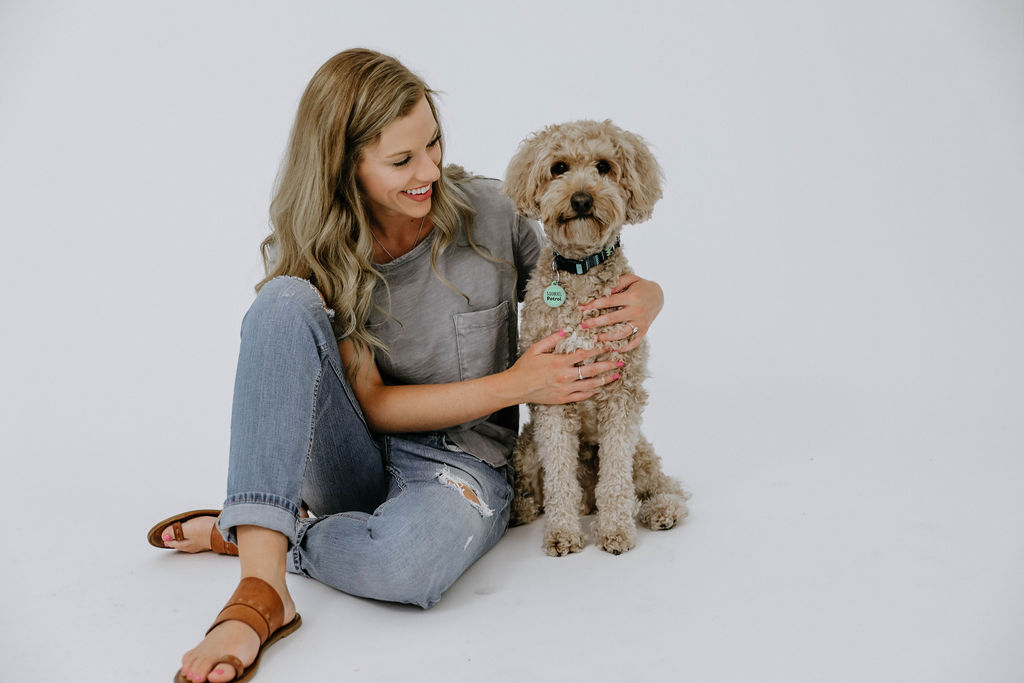 Macy Mullinax with her Golden doodle Sully