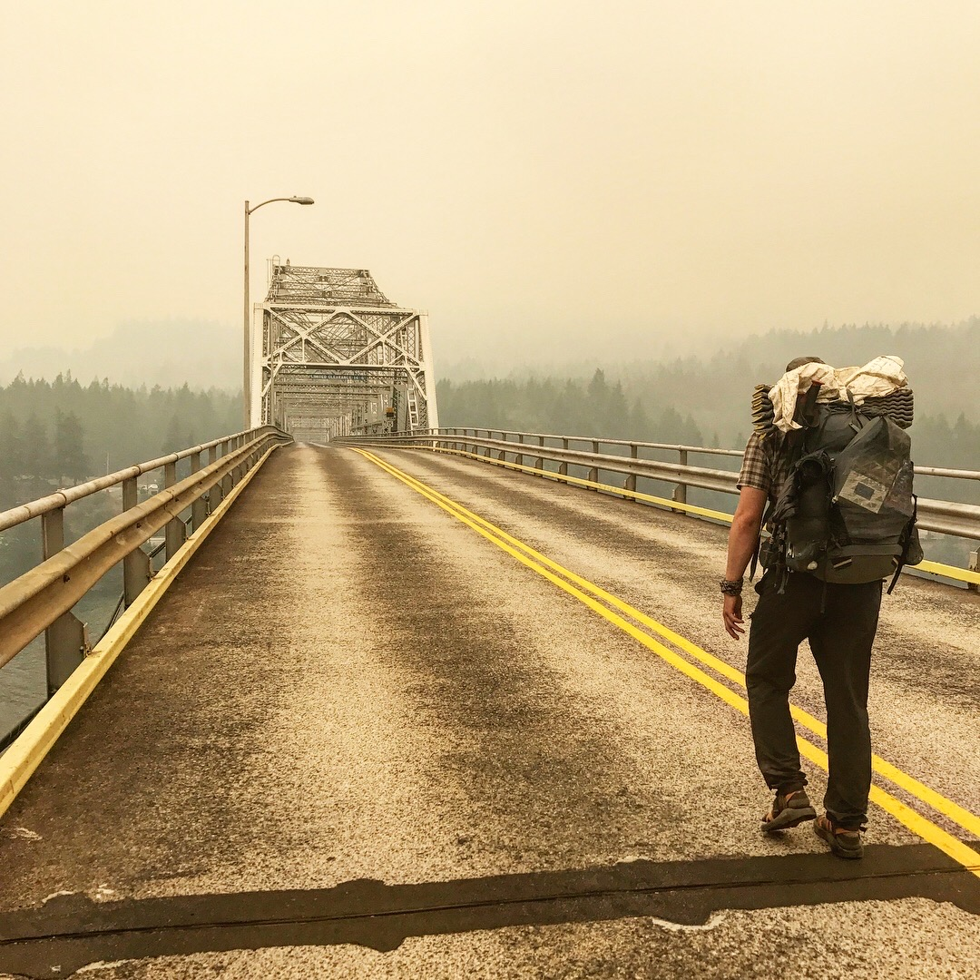 Vice walking from Washington to Oregon on the Bridge of the Gods