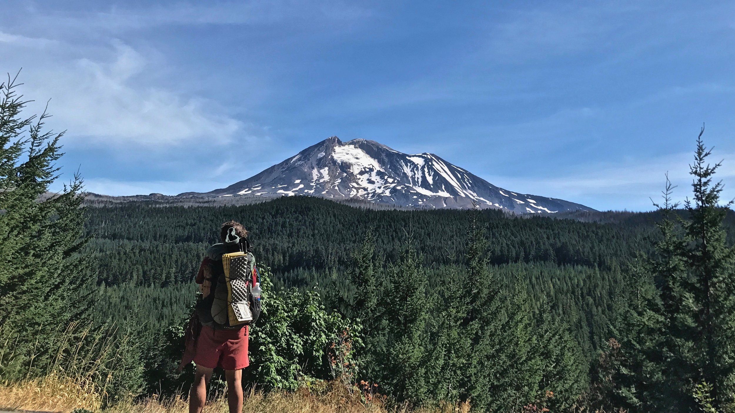 Alex and Mount Adams on the road walk back to trail