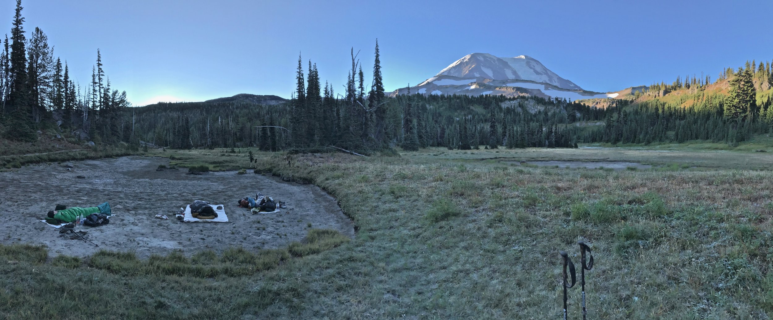 Sam, Vice, and Boathouse waking up under Mount Adams