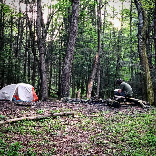 "APPALACHIAN TRAIL | DAY 77 | MAY 23: The fateful day when I took off the necklace that I NEVER take off. You can likely already infer what happened, but I'll fill in the details as part of my grieving process.  My papa gave me an eagle feather necklace before I started the PCT in 2017. It has since come with me on every trail. I took it off in the tent to give my neck a rest (sometimes its long chain gets twisted up while I sleep) and put it in the pocket of the tent. I went to bed.  Waking up at 5:00am, I packed up all my crap, shook out my tent (FATAL MISTAKE 😭😵🤦‍♀️), loaded my bag and hiked north.  18 miles later I felt my chest and the wave of oh-fuckery swept over me. Shame, hot-in-the-faceless, disappointment, tunnel vision. I stopped and went through everything—maybe I actually put it in a bag? Maybe it didn't fall out when I shook out the tent?—but no dice.  This picture is of exactly where it is probably laying in the gravel that I camped on."", waiting to be found. To end this without a total downer, the picture also shows my new friend Hot Toddy reading his AWOL book. Hot Toddy is an accountant from SoCal in 'real life' but he really doesn't want you to know the accountant part!  I know the necklace is just a thing, but it's a symbol of love for my dad and it's a way to bring him on all my adventures, so it's taking me a minute to get to the acceptance stage in the grieving process. I'm still having fantasies of going back to look for it."