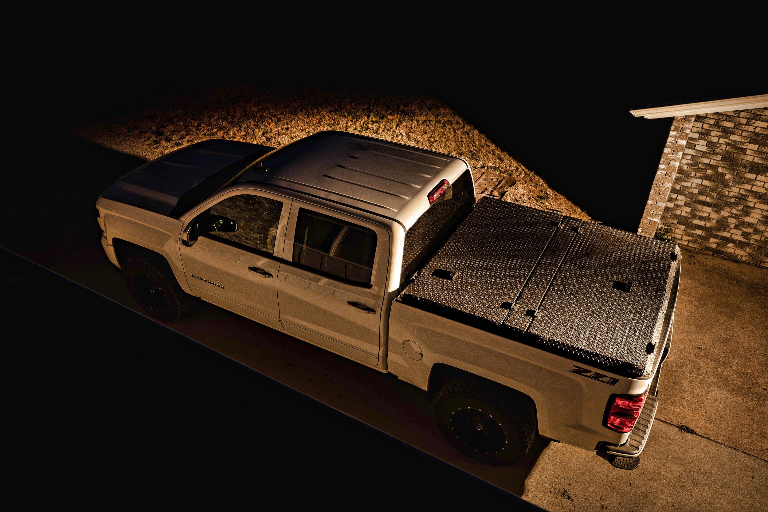 diamondback-hd-black-lifestyle-side-overhead-driveway-dark.jpg