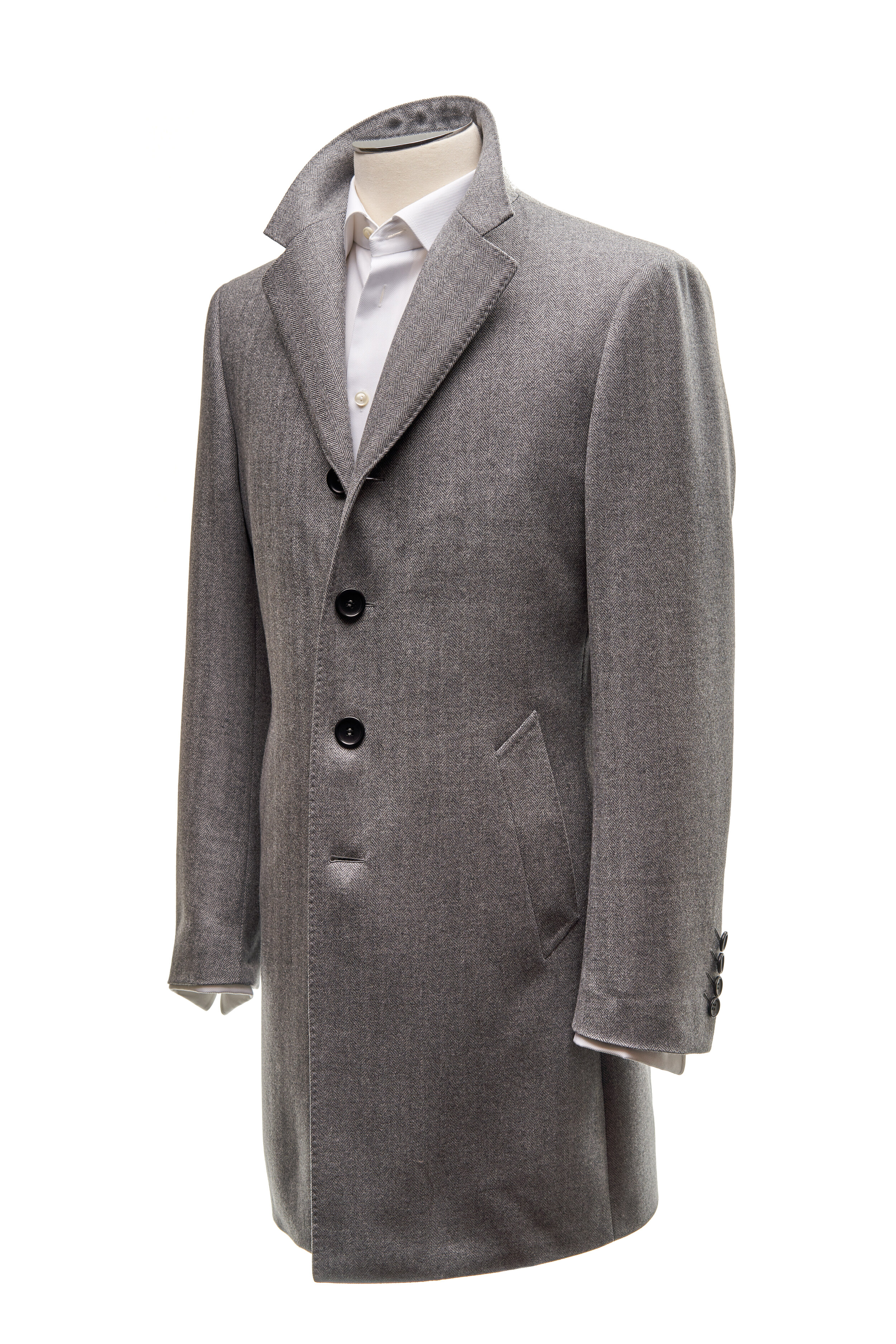 Herringbone Topcoat - Four button herringbone overcoat, with traditional high cut notch lapel. Slanted comfort welt pockets. Cloth composition 100% wool, 380g/m.