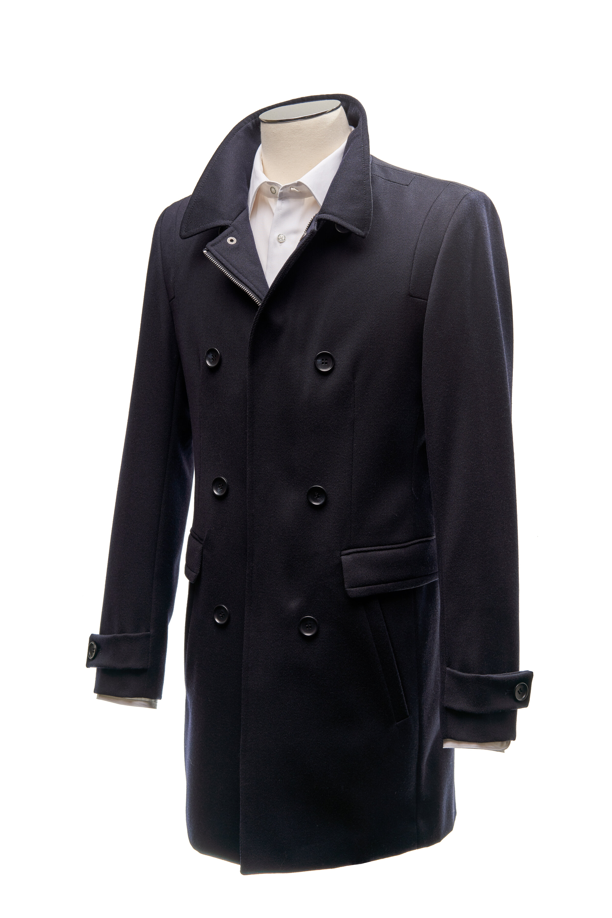 Navy Coating - Classic navy wool overcoat, six feature button, zipper front. Front pocket detail, with cuff button design.