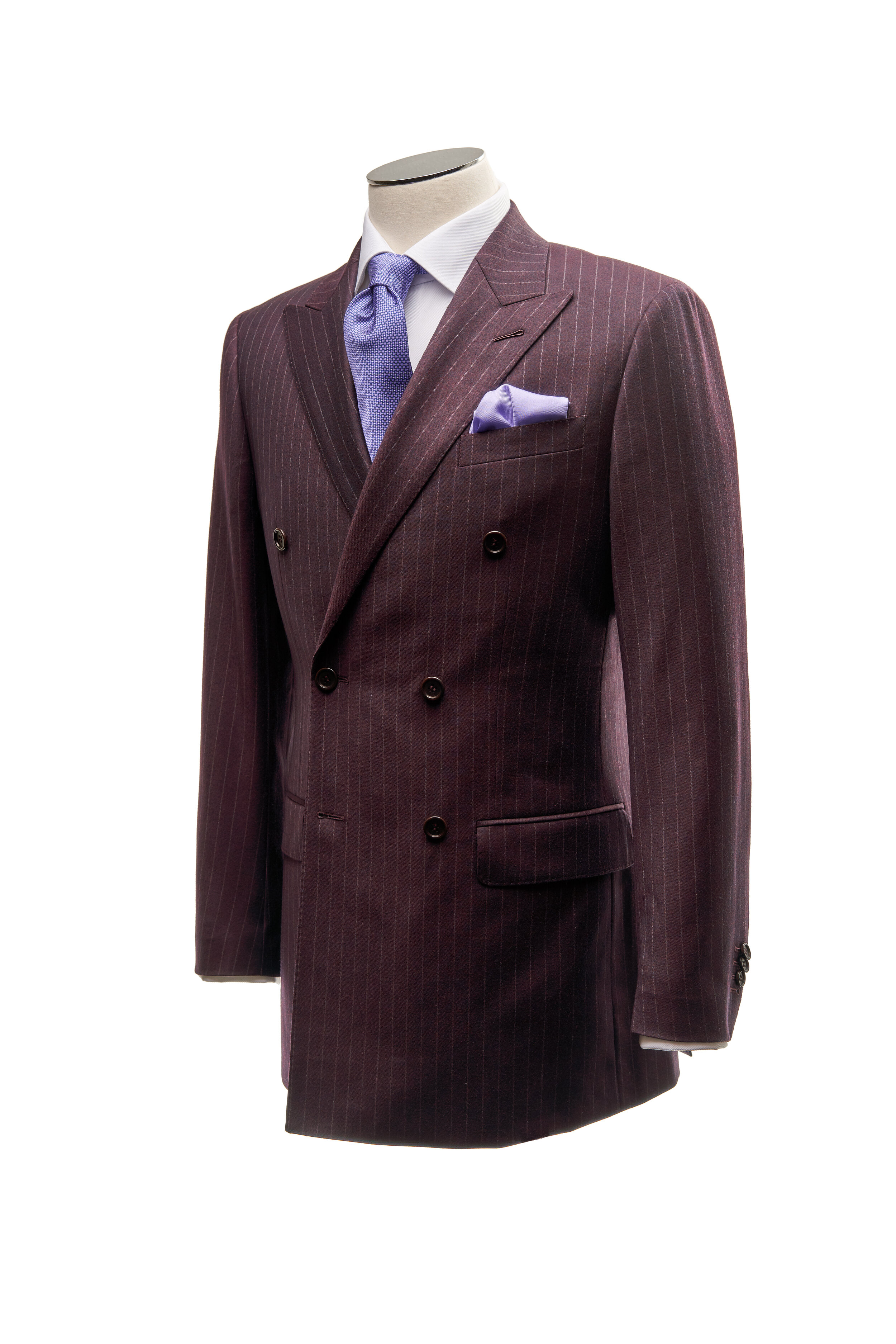 Burgundy Pinstriped - Double breasted burgundy pinstripe suit. Six button four closure, peak lapel. Cloth composition 100% wool, Super 110's, 290g.