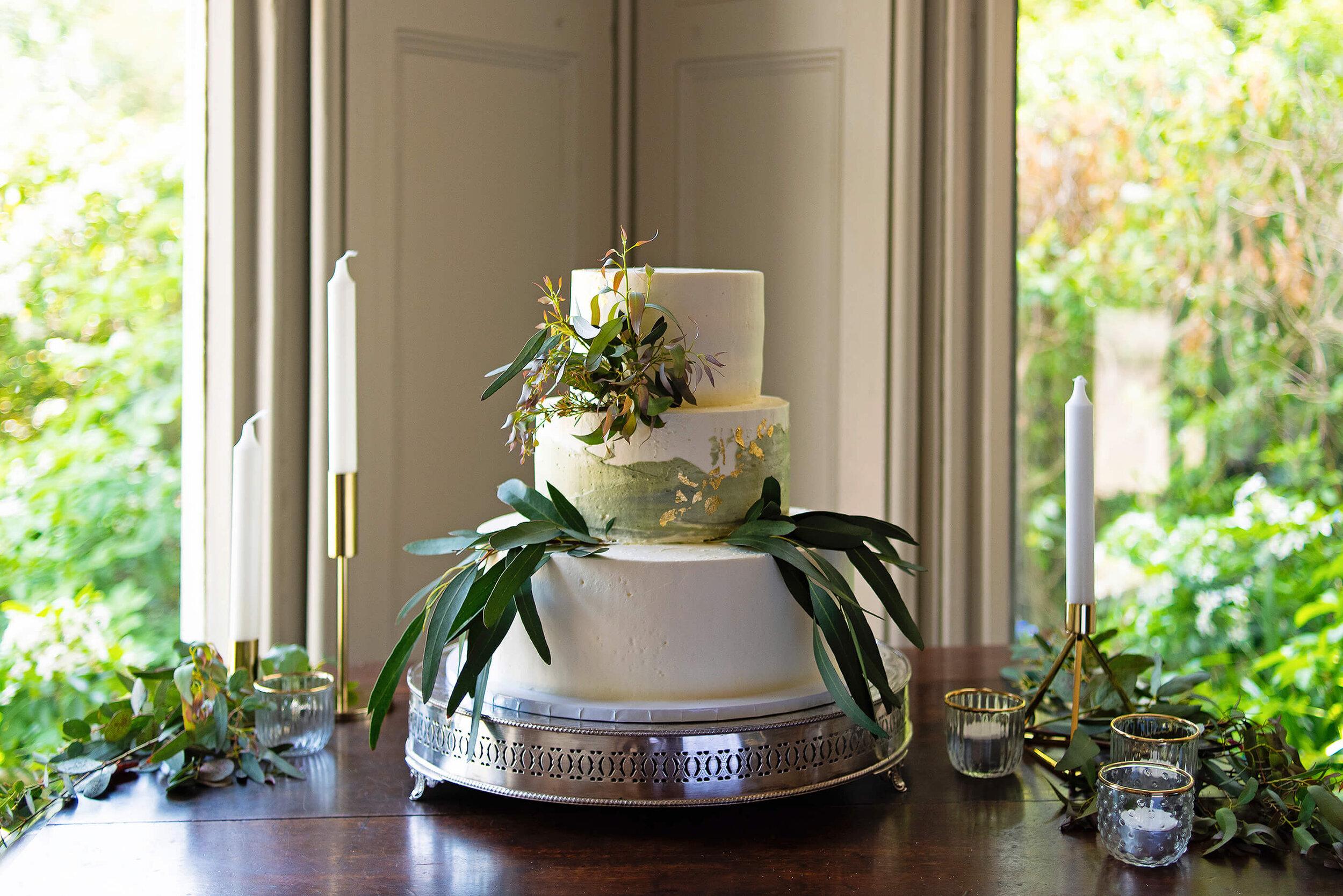 Cakes & Leaves Three Tier Eucalyptus Foliage and Gold Leaf Wedding Cake at Nurstead Court.