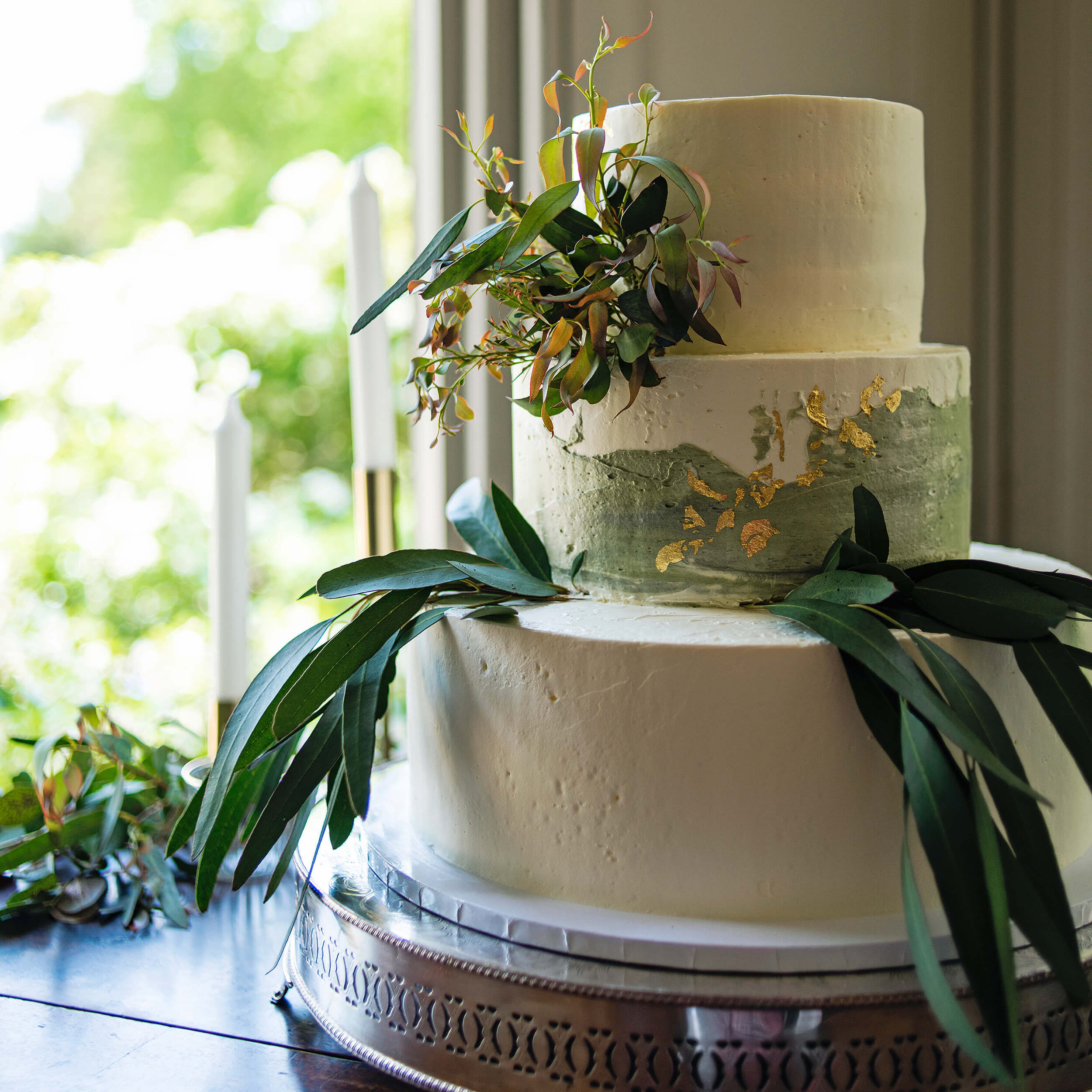 Cakes & Leaves Three Tier Eucalyptus Foliage and Gold Leaf Wedding Cake details at Nurstead Court Wedding venue, Kent.