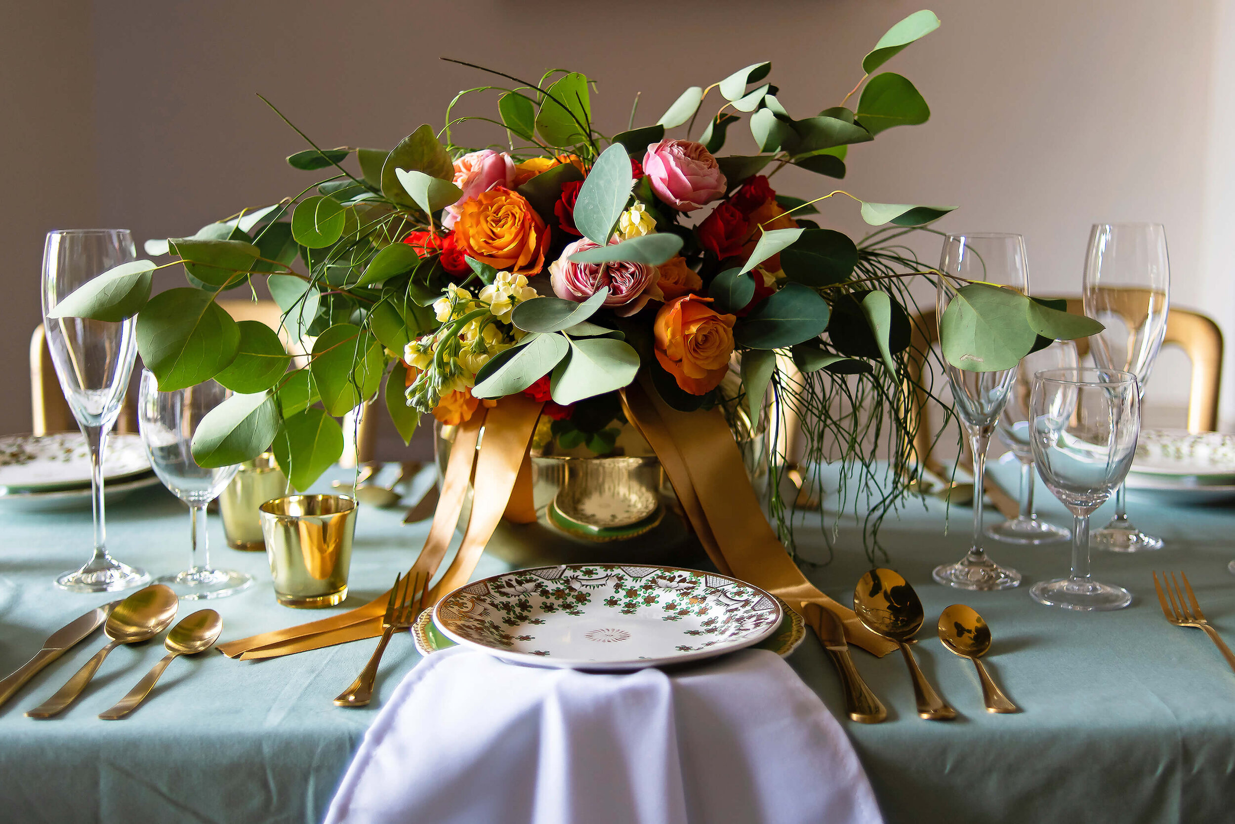 Table setting with floral and foliage center piece at Nurstead Court Wedding Venue, Kent.