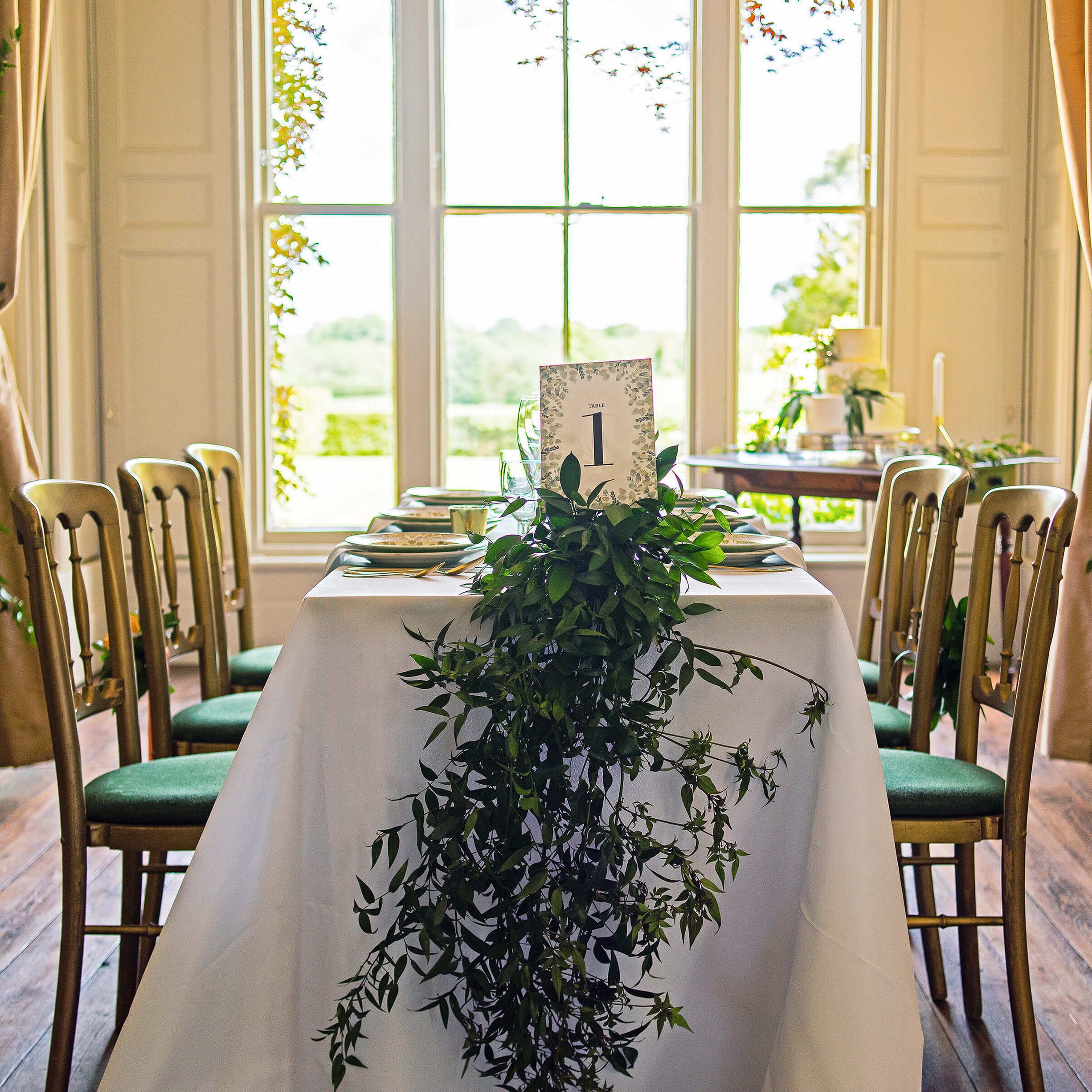 Table setting with Eucalyptus foliage center piece and Design By Emily Eucalyptus Table Number Card, at Nurstead Court Wedding Venue, Kent.