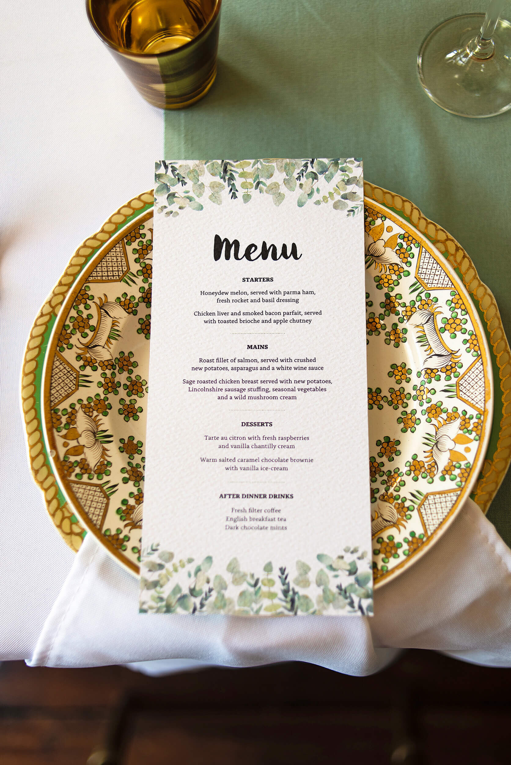 Design By Emily Rustic Eucalyptus Wedding Menu on plate at Nurstead Court Wedding Venue, Kent.