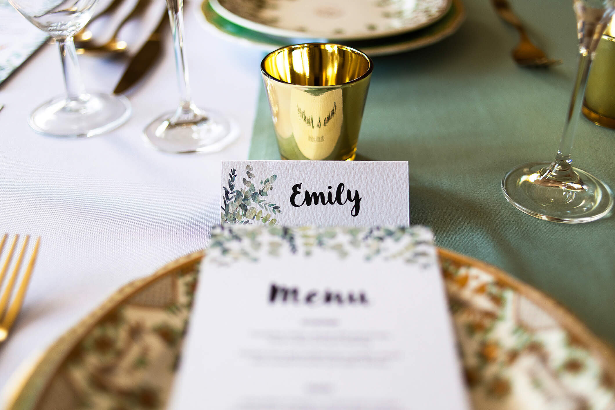 Design By Emily Rustic Eucalyptus Wedding Menu on plate and place name card, at Nurstead Court Wedding Venue, Kent.