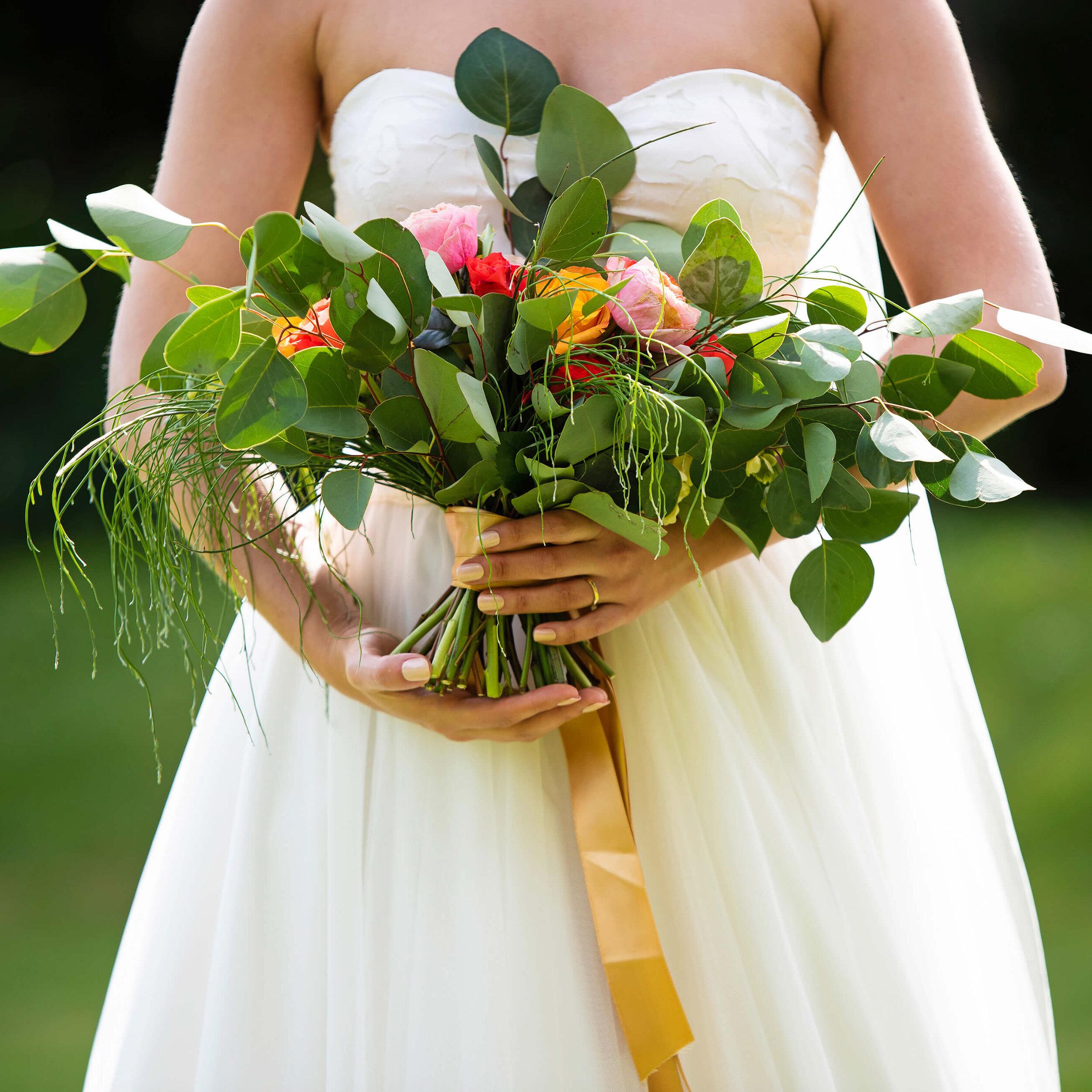 Bride with Davina Simone Weddings floral and foliage bouquet at Nurstead Court Wedding Venue, Kent.