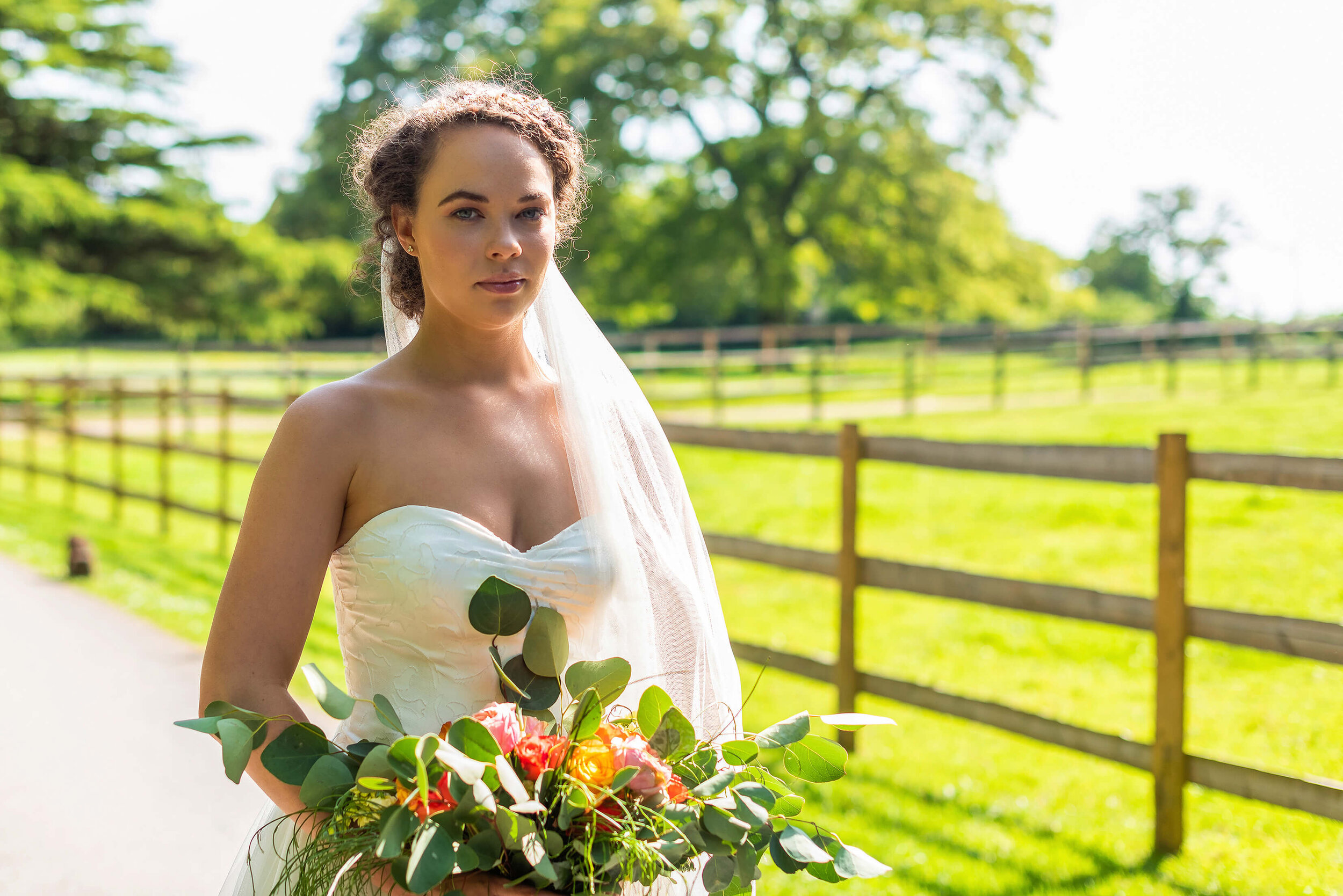 Bride in Oui Madam Bridal Atelier dress, with Davina Simone Weddings floral and foliage bouquet and Sash & Veil Bridal veil at Nurstead Court Wedding Venue, Kent.