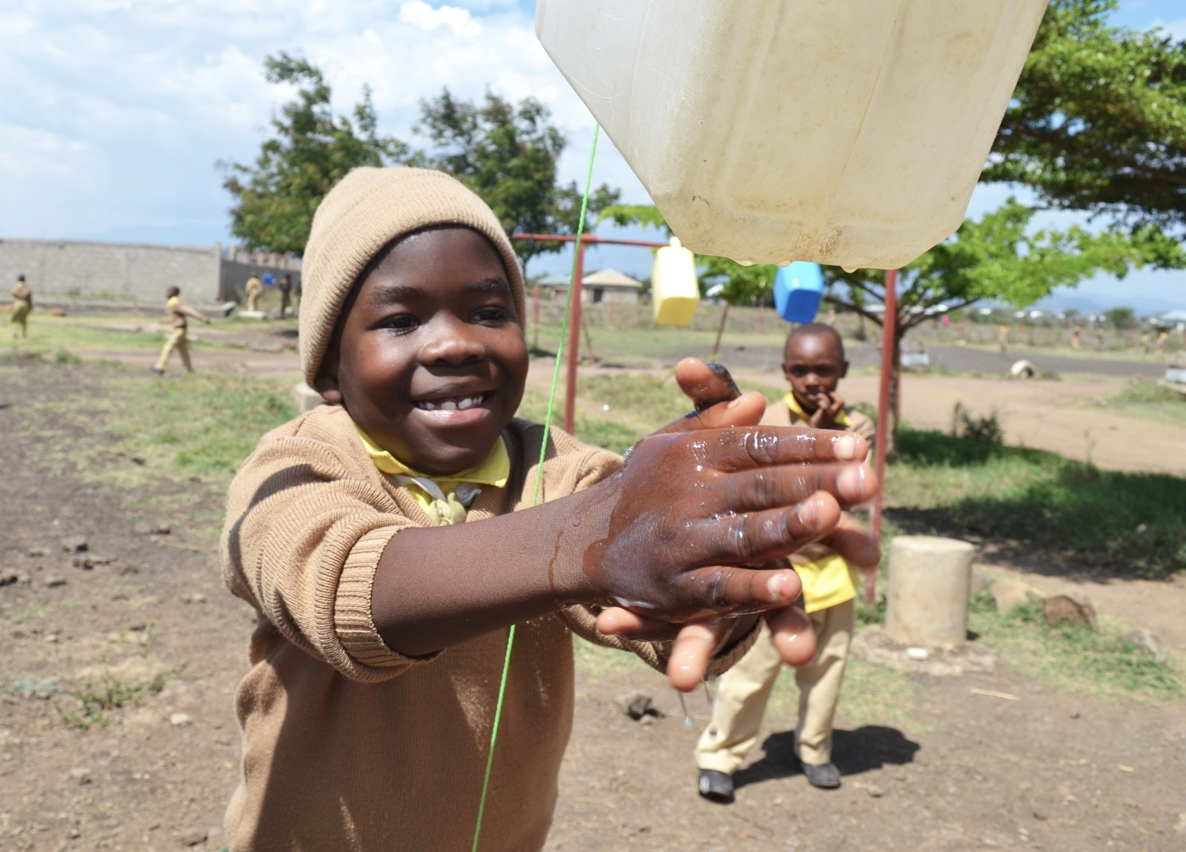 OUR IMPACT - So far we have built 14 toilets, 12 hand washing stations and student hand washing workshops.